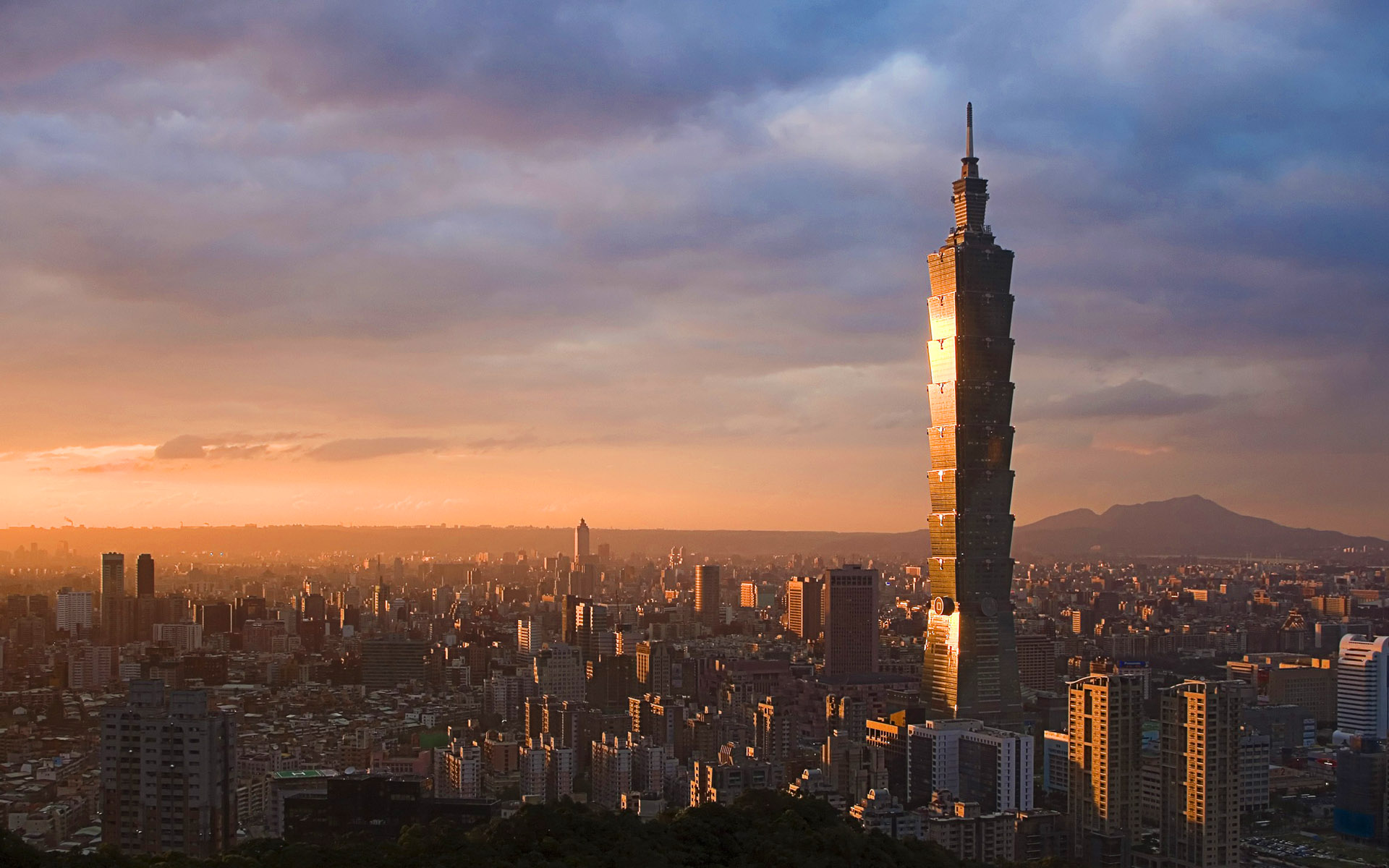 taipei 101 Taipei 101 was designed to resemble a gigantic bamboo stalk it's impossible to miss every day the tip of taipei 101 is lit up a different color.