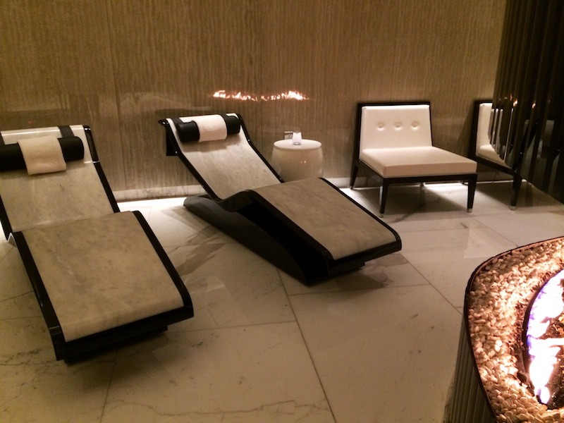 Heated marble loungers and a roaring fire