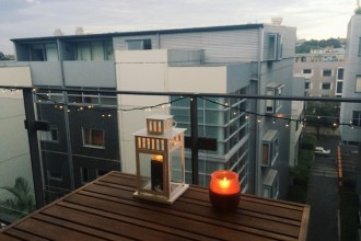 Our balcony at dusk - it takes more than a candle to keep me safe from bites