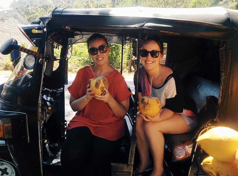 Stopping at a roadside coconut stand for refreshment