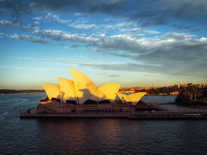 A cruise ship casts a shadow on the Opera House
