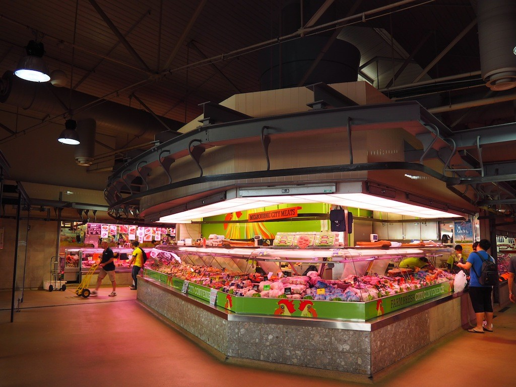 Fresh meat is bought into the market hall using rails and pulleys on the ceiling