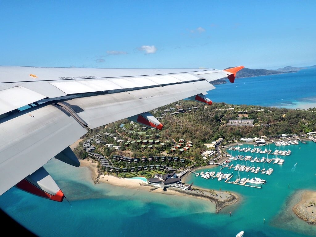 Waving goodbye to Hamilton Island on Jetstar to Sydney
