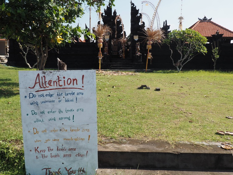 A sign at an unattended temple on Echo Beach, Canggu, lays out the local customs