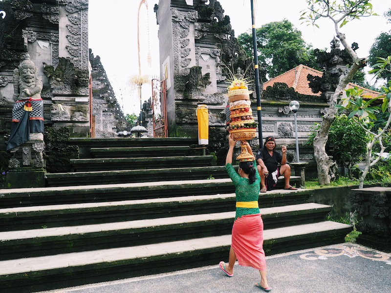 Women bring offerings to the temple ahead of the Nyepi Day celebrations