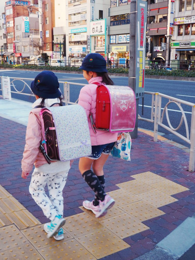 Young girls walking themselves to school in Tokyo