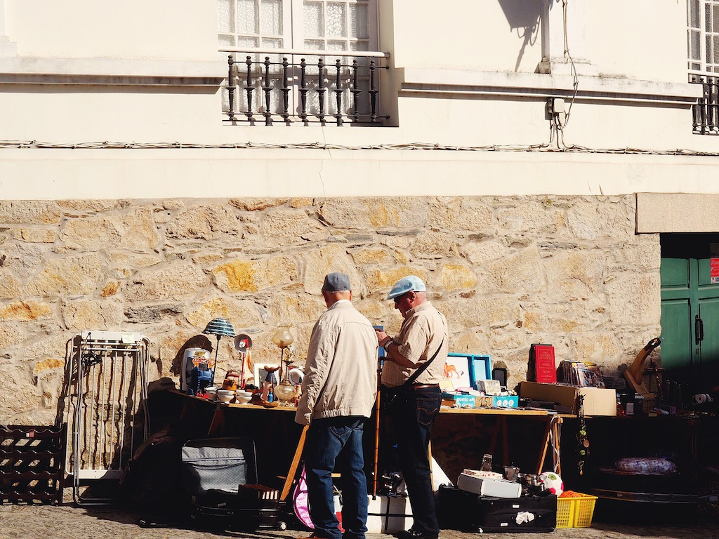 Old men browsing the weekend market in Pontedeume