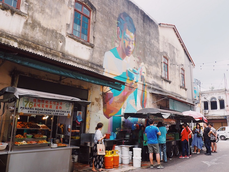Mural of boy eating Penang Road famous cendol by by Canadian street artist Emmanuel Jarus