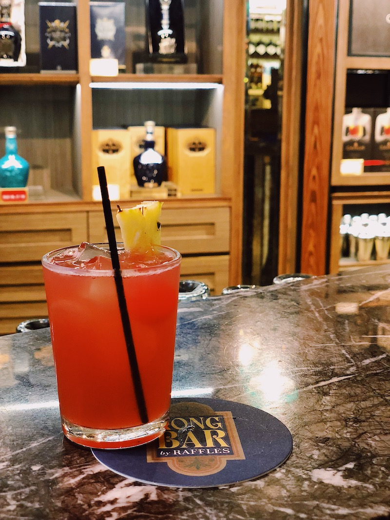 Singapore Sling at Raffles Long Bar Singapore Changi Airport