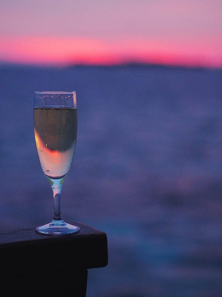 Champagne at sunset in the Maldives