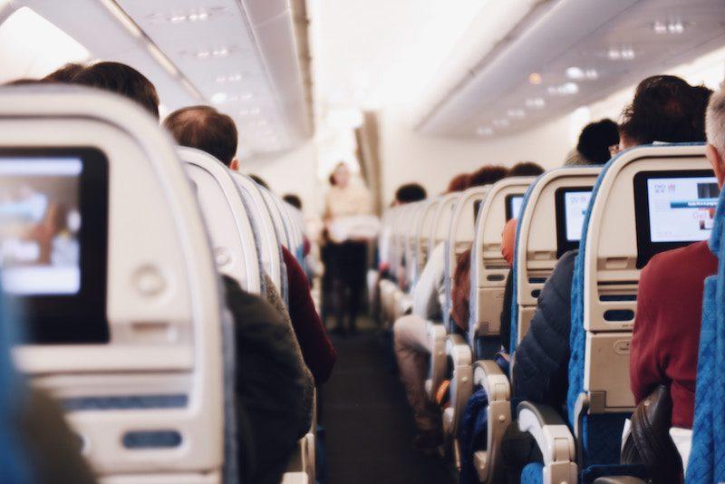 How best to sleep on a plane In economy class | Girl Tweets World | Photo bySuhyeon ChoionUnsplash